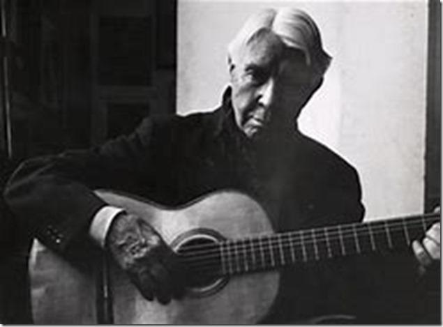 Carl Sandburg wth guitar
