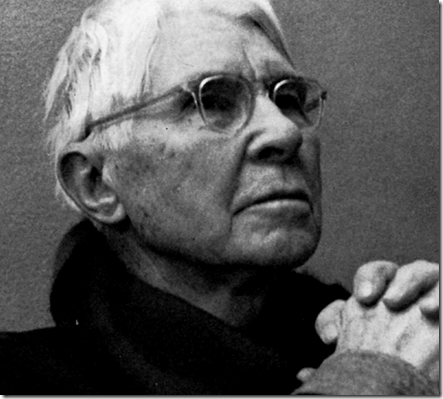 Carl Sandburg in black cowl-neck