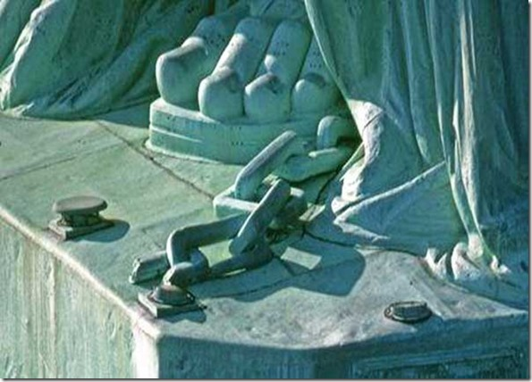 Statue of Liberty chains at her feet